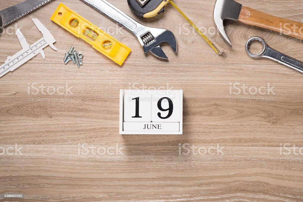 Mix of work tools on wood stock photo