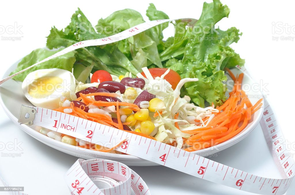 Mix vegetables salad with tape measure, food health concept stock photo