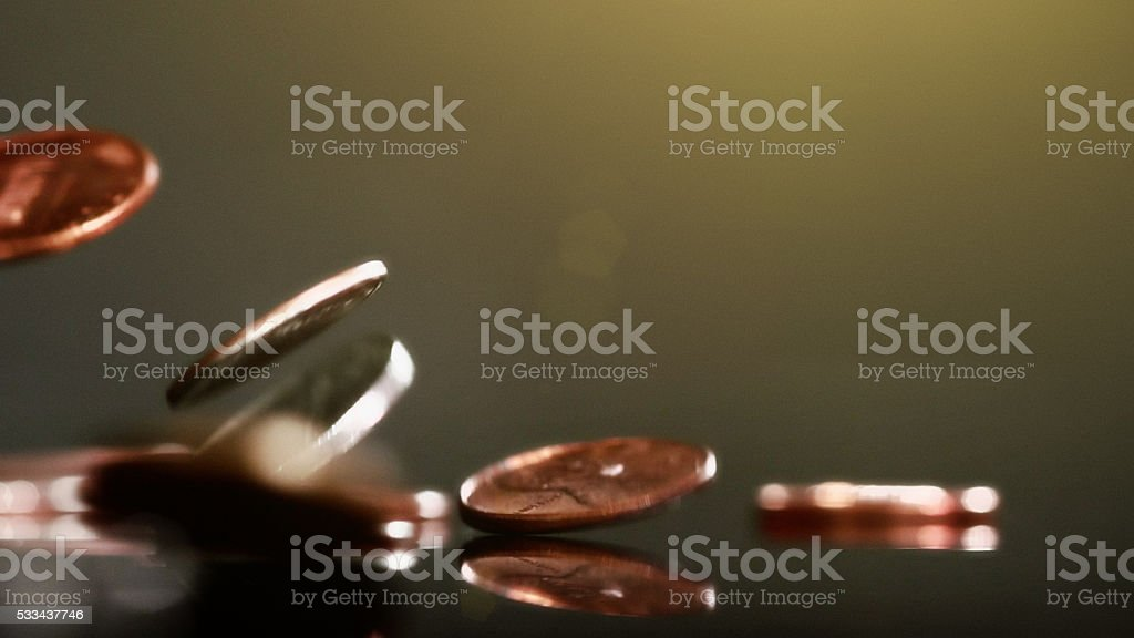 Mixed American coins falling, showing motion blur stock photo