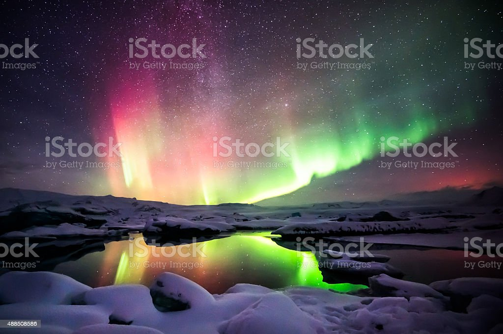 Mixed aurora dancing over the Jokulsarlon lagoon, Iceland stock photo