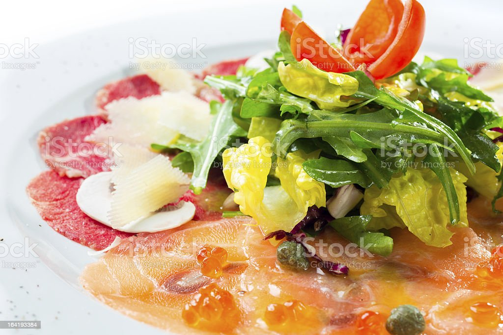 Mixed beef and salmon carpaccio royalty-free stock photo