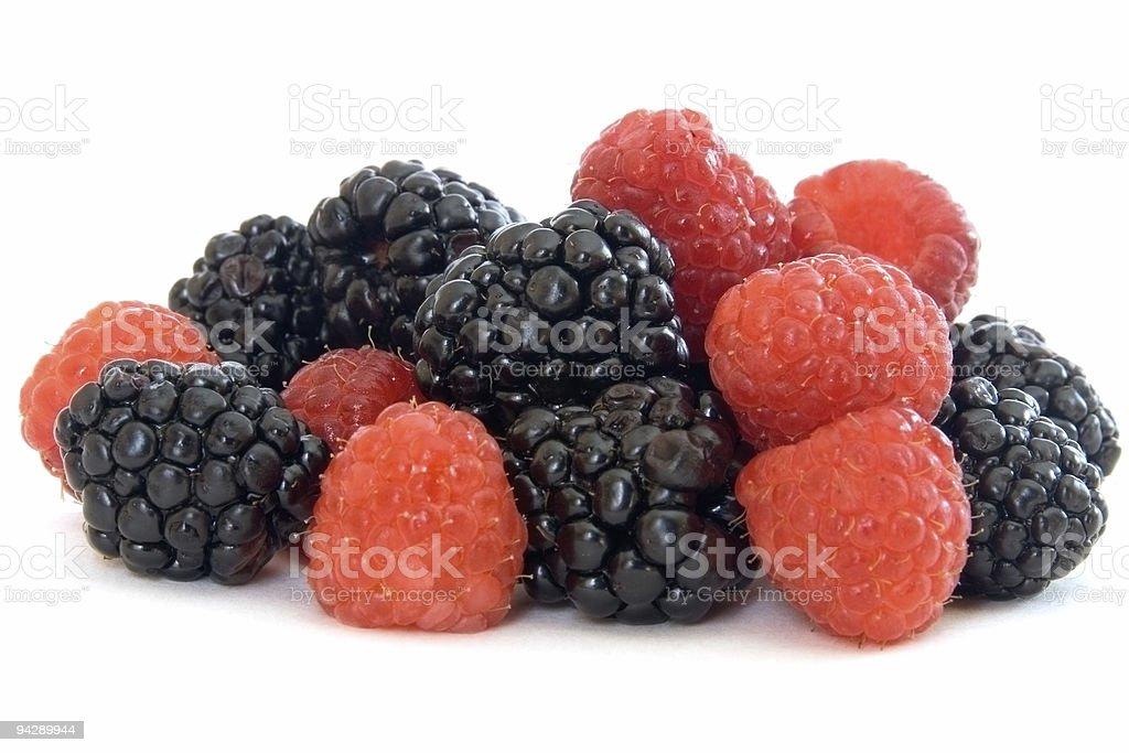 Mixed berries - raspberries and  blackberries on white royalty-free stock photo
