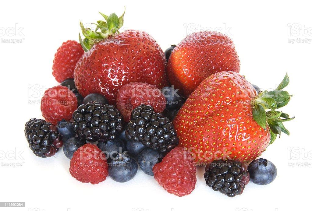 Mixed berries - strawberries, raspberries, blackberries and  blueberries on white royalty-free stock photo