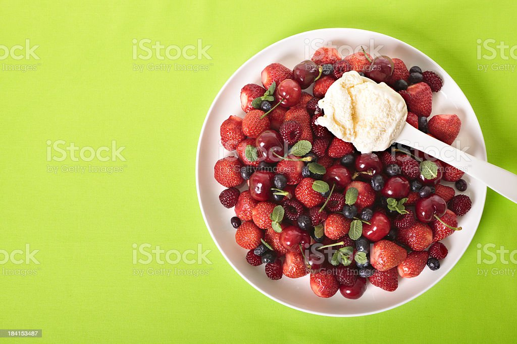 Mixed berries with ice cream royalty-free stock photo