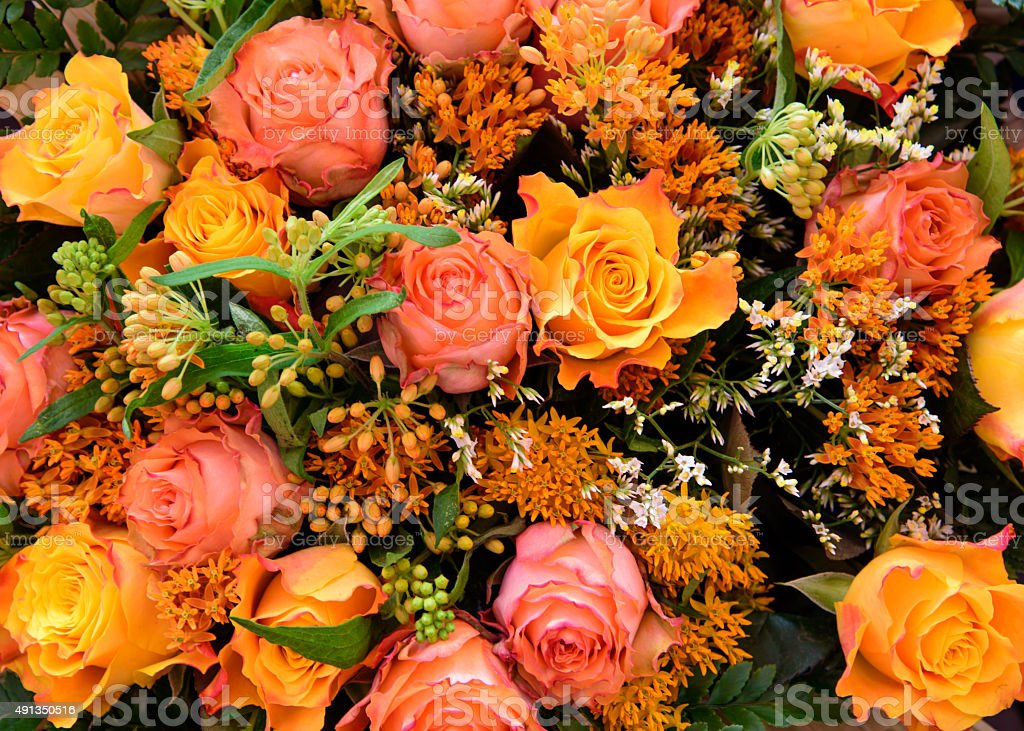 Mixed boquet with autumn colored roses stock photo