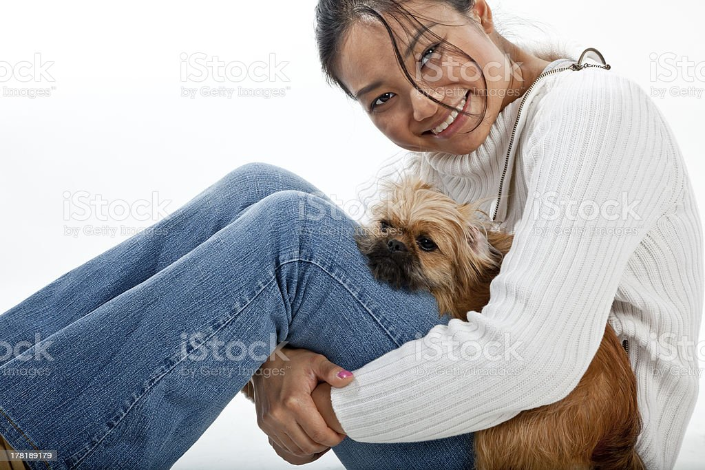 Mixed breed 'Porkie' with owner stock photo