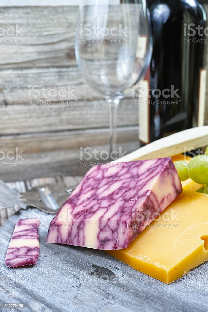 Mixed cheese, marble cheddar, green grape and wine stock photo