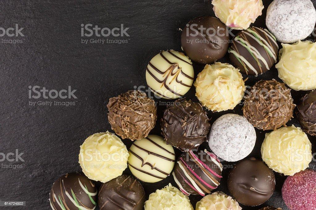 mixed chocolate truffles background stock photo