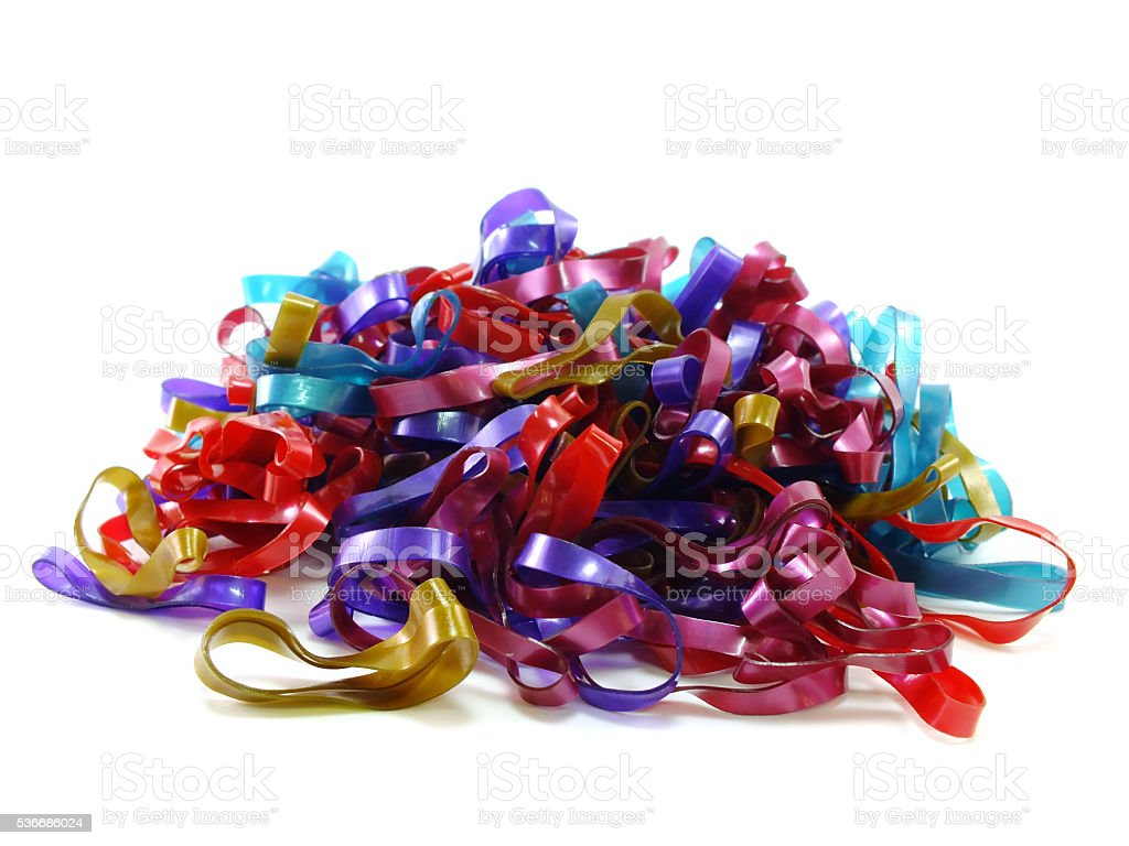 mixed color elastic bands on the white background stock photo