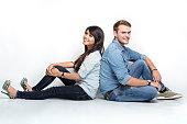 Mixed couple sitting on the floor