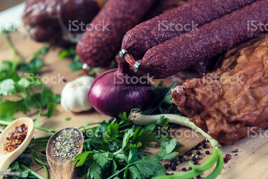 Mixed Deli Meats with Fresh Vegetables and Spices stock photo