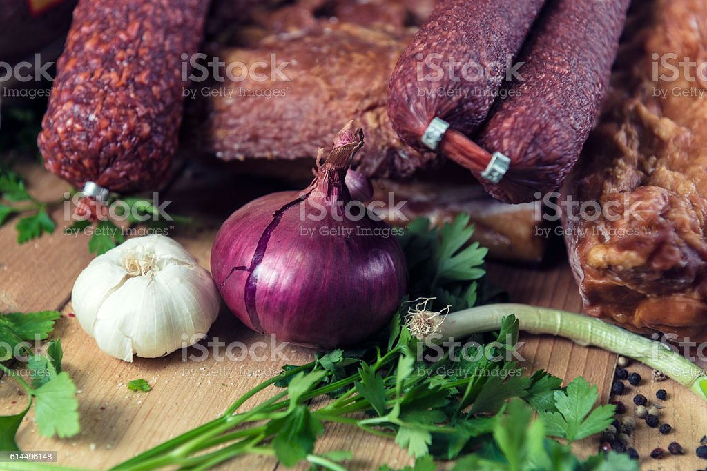 Mixed Deli Meats with Fresh Vegetables on Wooden Table stock photo