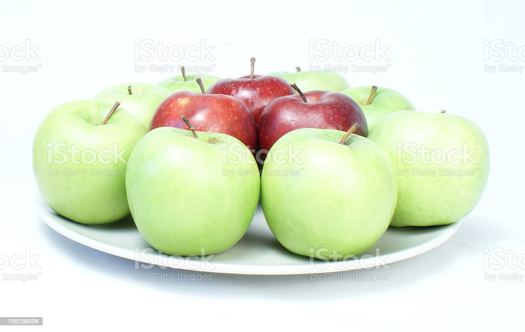 Mixed dish of apples red and green stock photo
