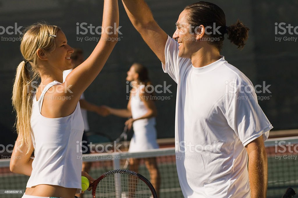 Mixed Doubles Partners High-Fiving Each Other stock photo