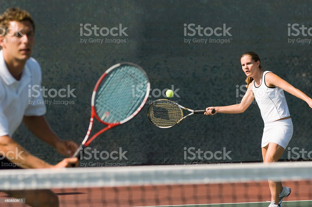 Mixed Doubles Partners in Tennis Match stock photo