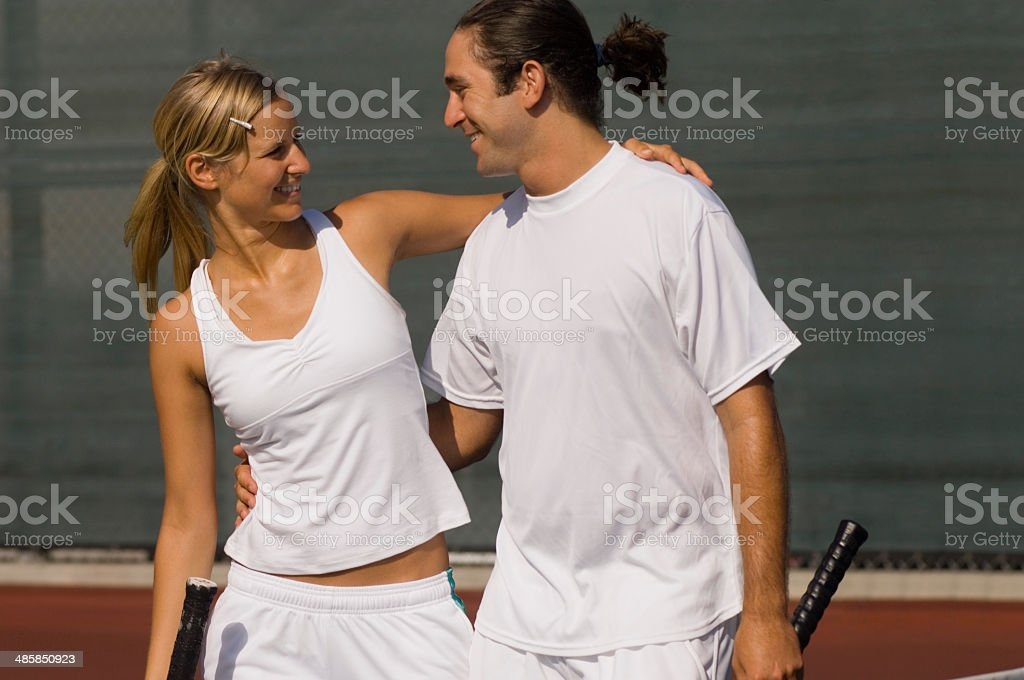 Mixed Doubles Partners on Court stock photo