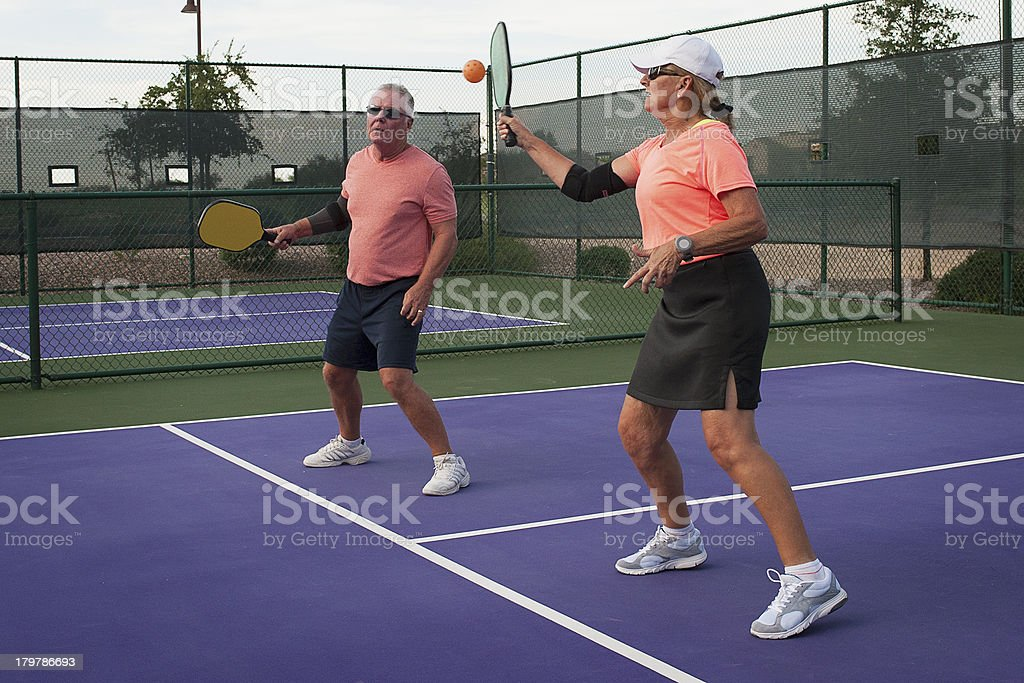 Mixed Doubles Pickleball Action - Forehand for the Point royalty-free stock photo