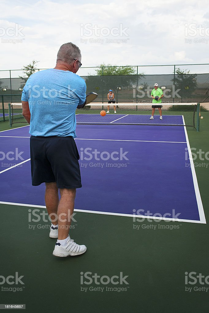 Mixed Doubles Pickleball Action - The Serve royalty-free stock photo