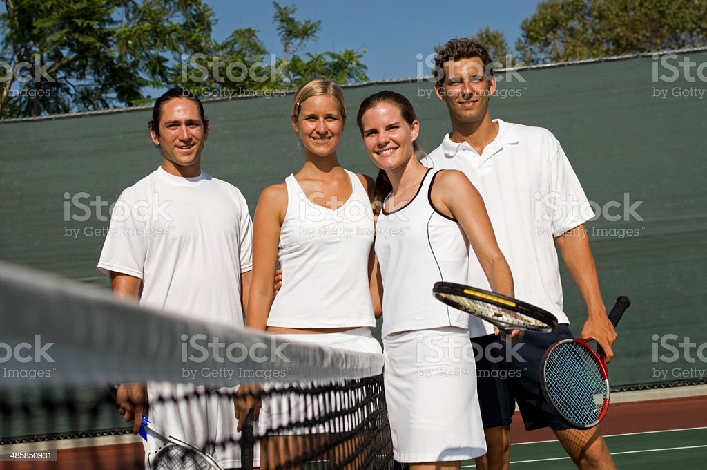 Mixed Doubles Tennis Players at Net stock photo