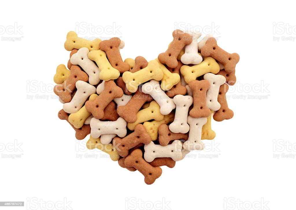 Mixed dried dog biscuits in a heart shape stock photo