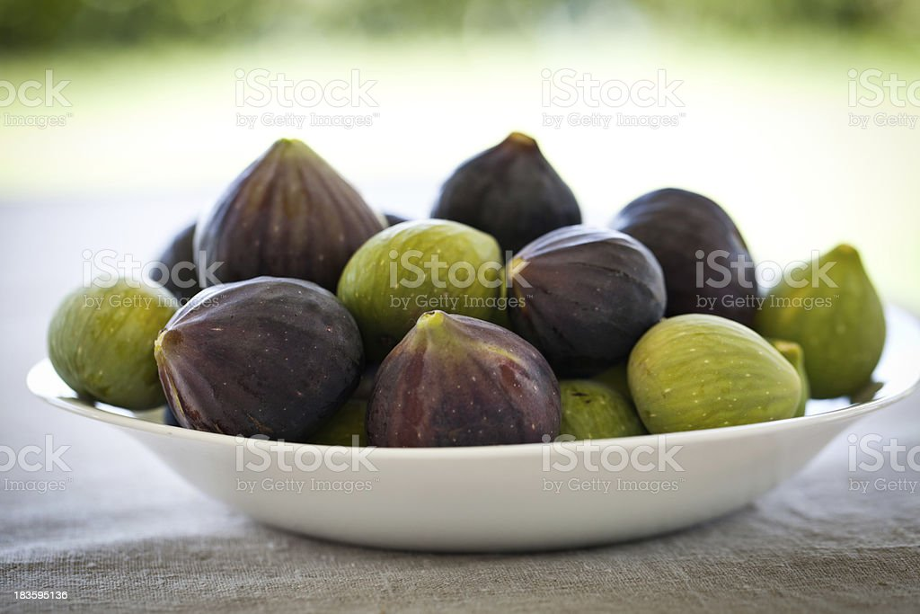 Mixed figs in the bowl royalty-free stock photo