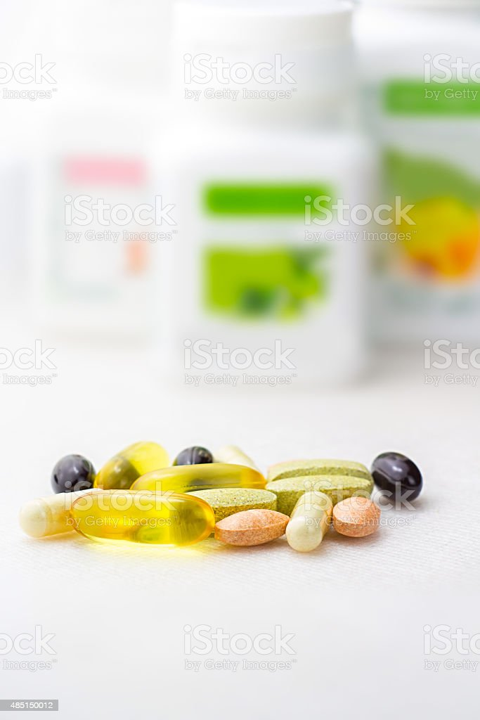 Mixed food supplement pills close-up, omega3, carotine, vitamins stock photo