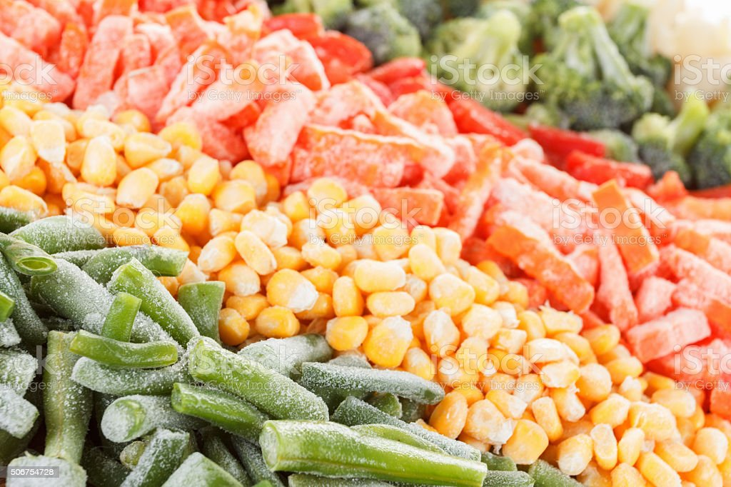 Mixed frozen vegetables background stock photo