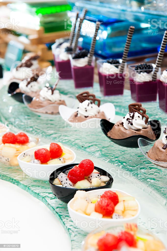Mixed Fruits Salad and Fancy cake in buffet line decor stock photo
