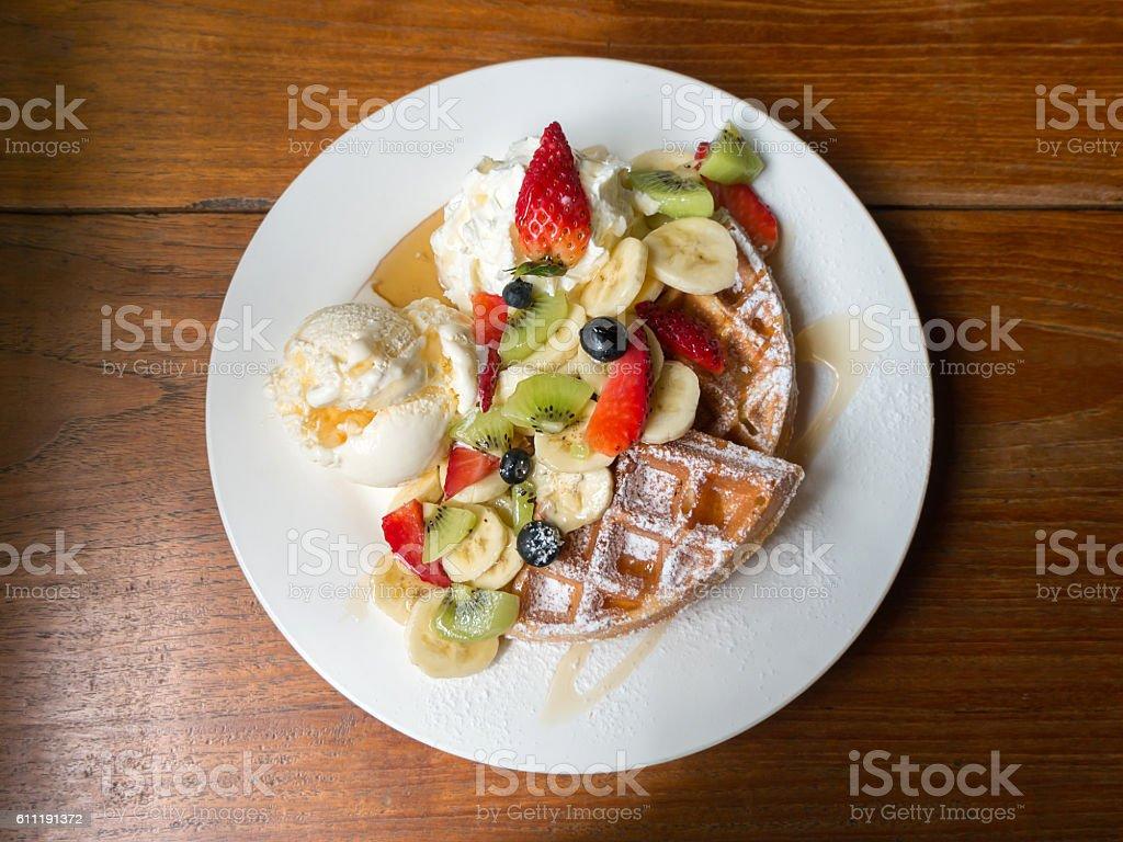 Mixed fruits waffle with ice cream stock photo