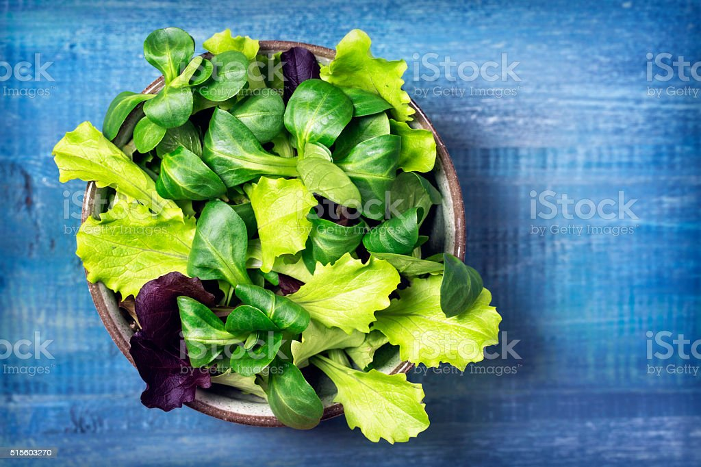 Mixed green salad leaves in a bowl stock photo