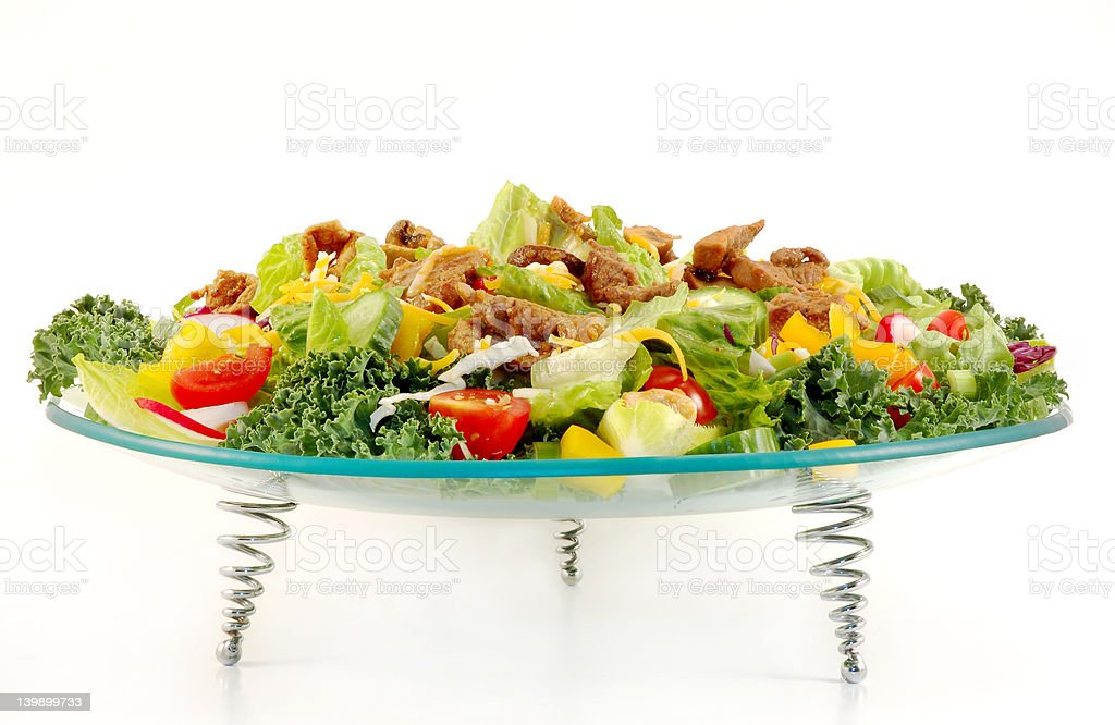 Mixed green salad with beef meat presented  on a  plate royalty-free stock photo