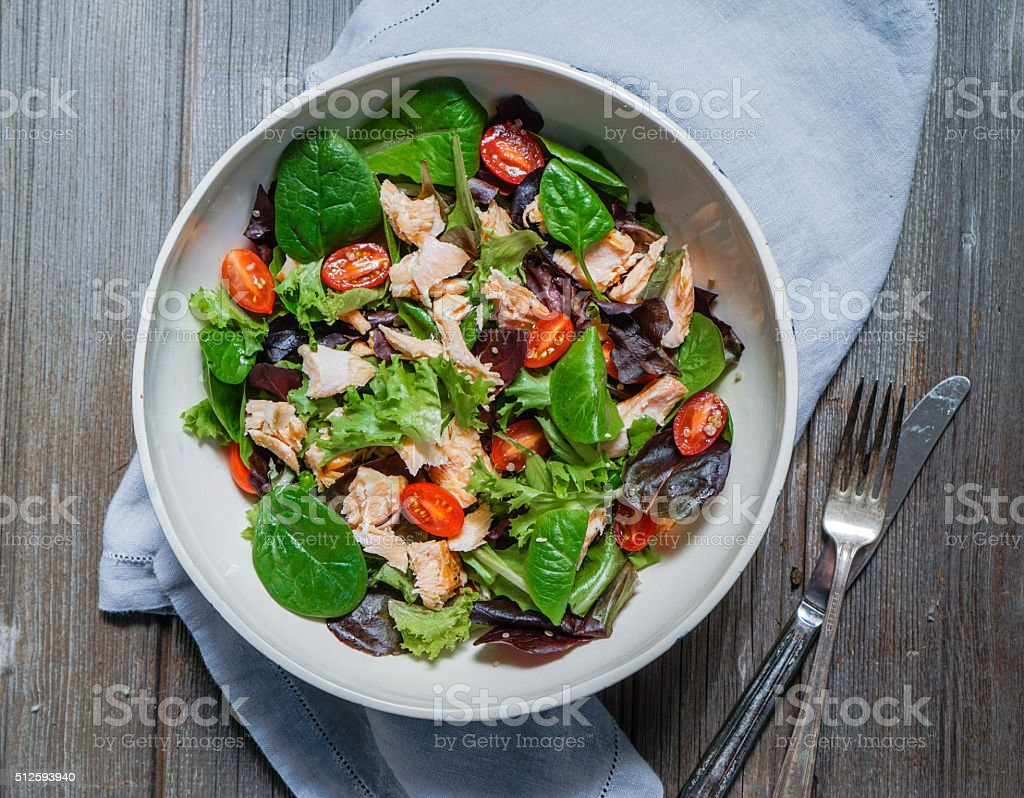 Mixed Green Salad with Grilled Salmon, Quinoa and Tomatoes stock photo