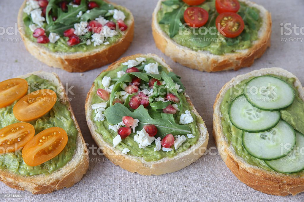 Mixed green sourdough open face sandwiches toast,toning stock photo