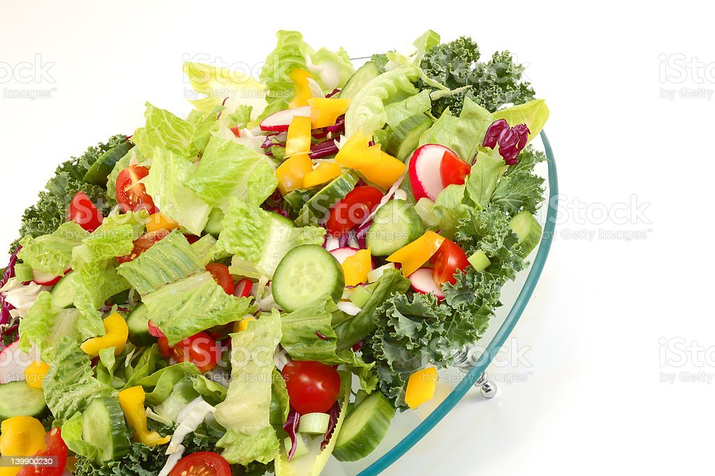 Mixed green vegetables on glass plate royalty-free stock photo