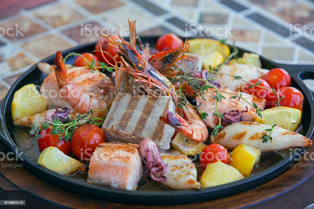 Mixed grilled seafood on iron pan stock photo