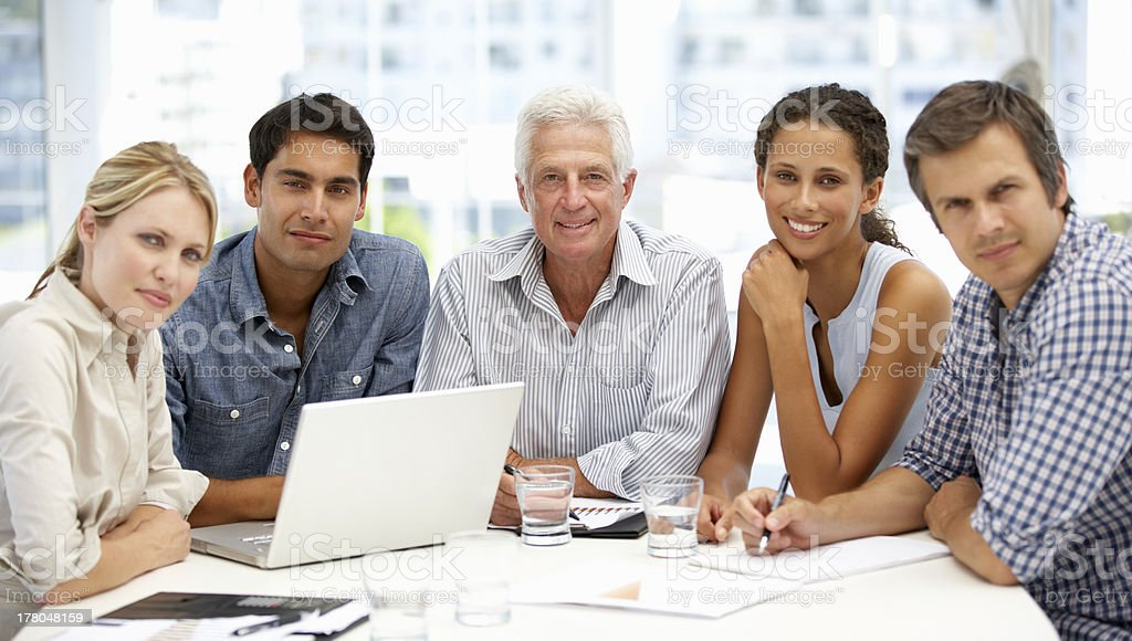 A mixed group in a business meeting stock photo