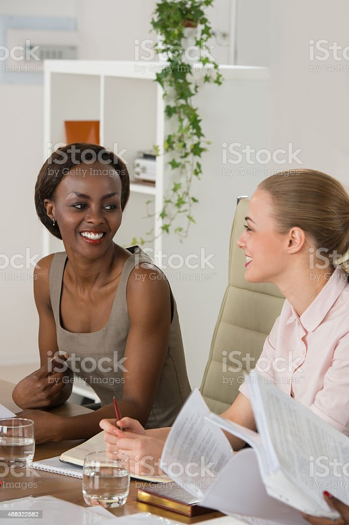 Mixed group in business meeting women only stock photo