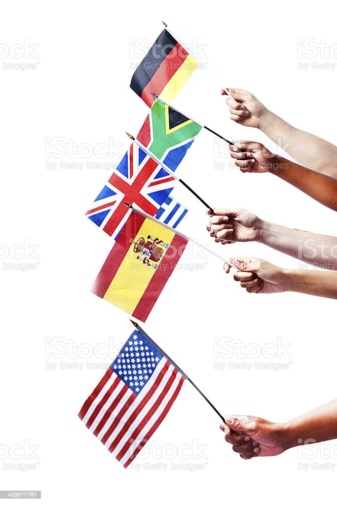 Mixed hands holding many national flags stock photo