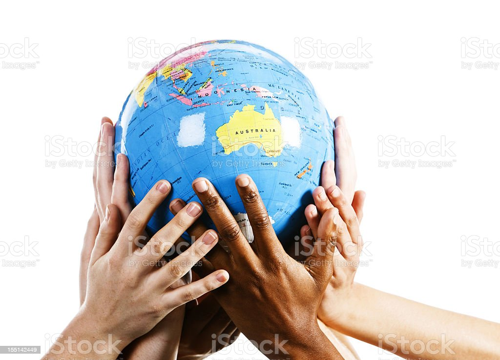 Mixed hands show environmental awareness by cradling a world globe royalty-free stock photo