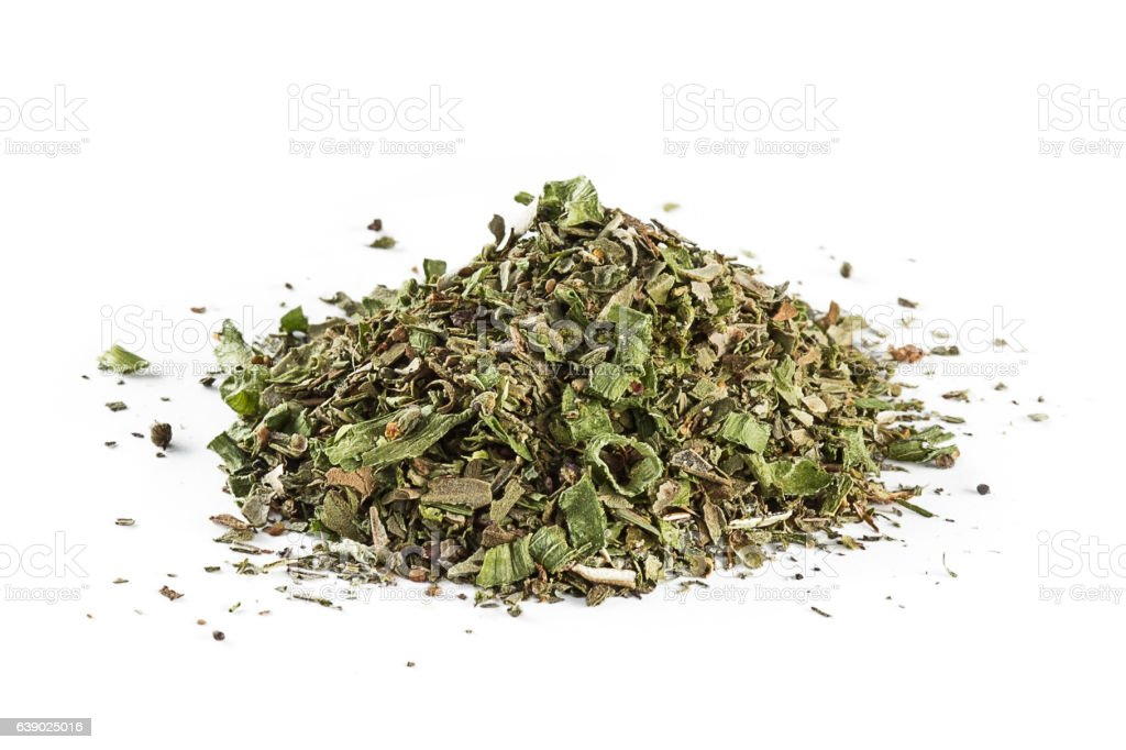 mixed Italian herb seasoning on a white background stock photo