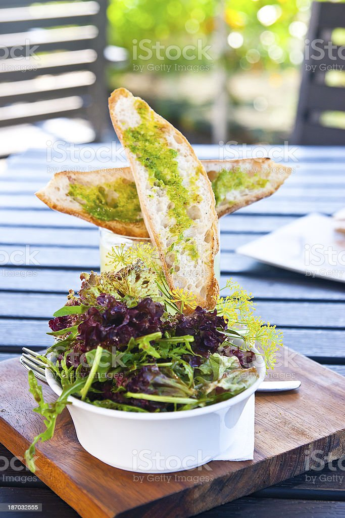 Mixed leaf salad with herb baguette royalty-free stock photo