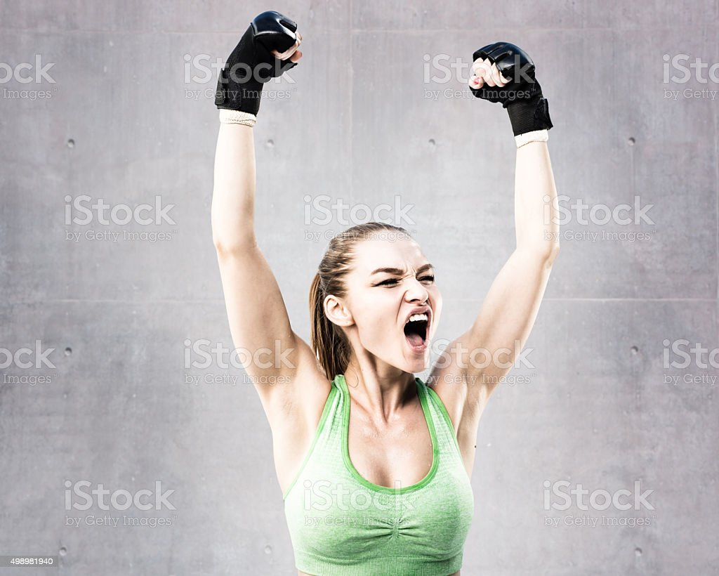 Mixed Martial Artist Celebrating a Victory stock photo