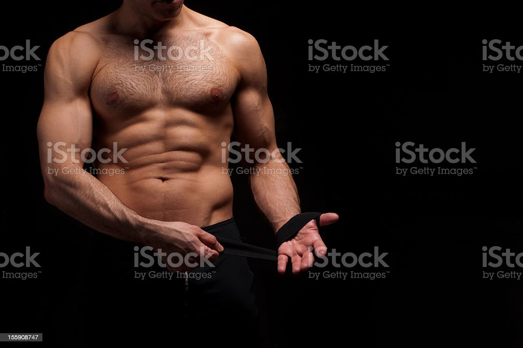 MMA - Mixed Martial Arts fighter putting on his hand-wrap stock photo