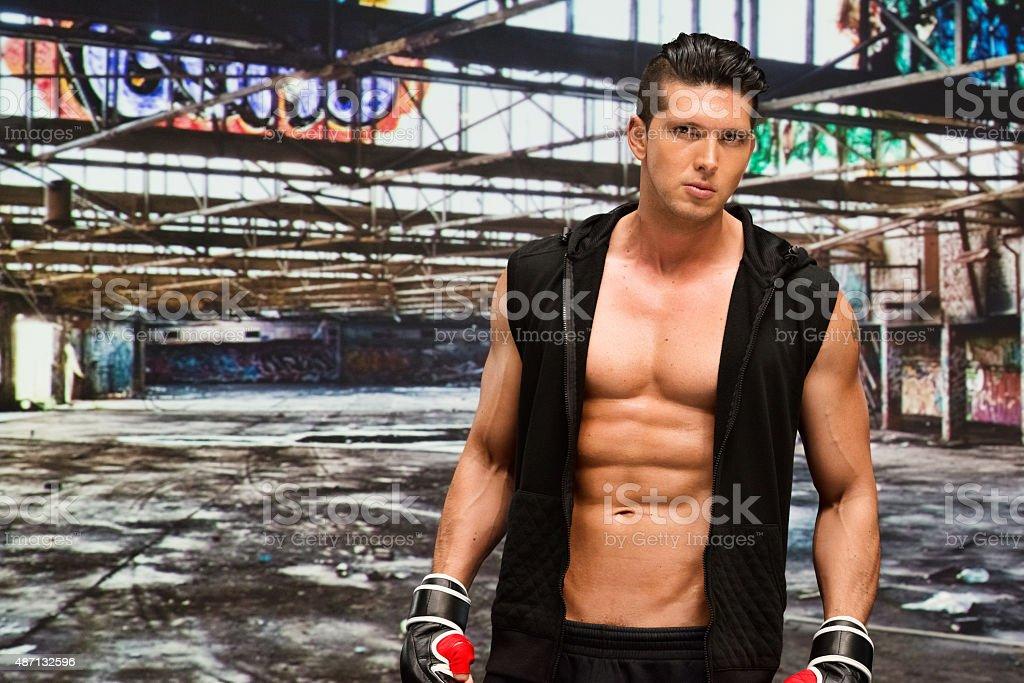 Mixed martial arts player at abandoned place stock photo