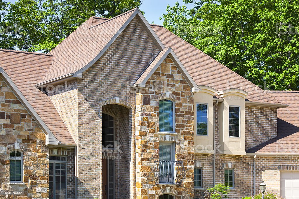 Mixed Material Home Design With Stucco, Brick, Stone royalty-free stock photo