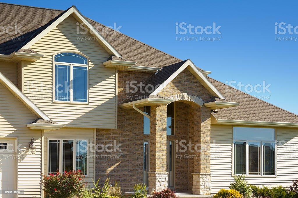 Mixed Materials House With Stone, Brick, Vinyl Siding stock photo