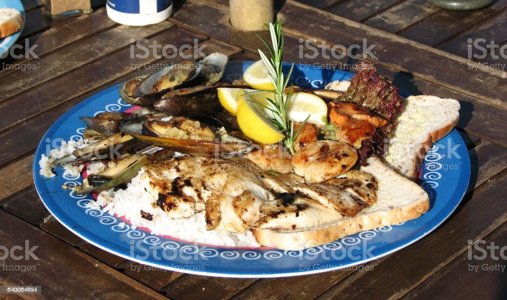 Mixed meat and seafood dish. stock photo