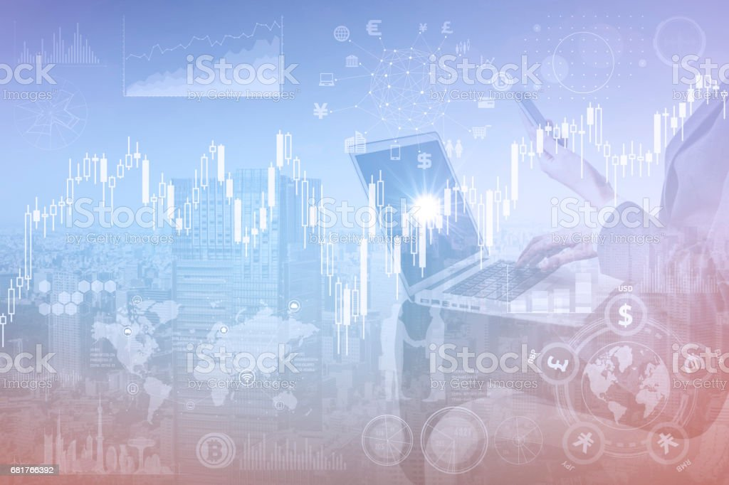 mixed media of candlestick chart and financial technology stock photo