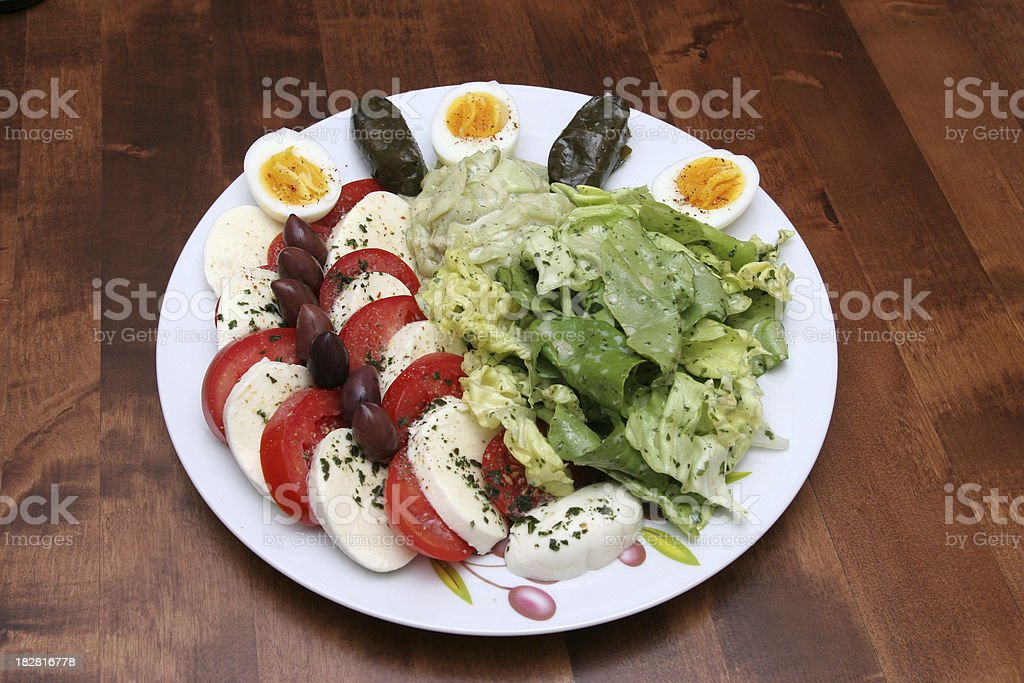 mixed mediterran salad on a wooden table royalty-free stock photo