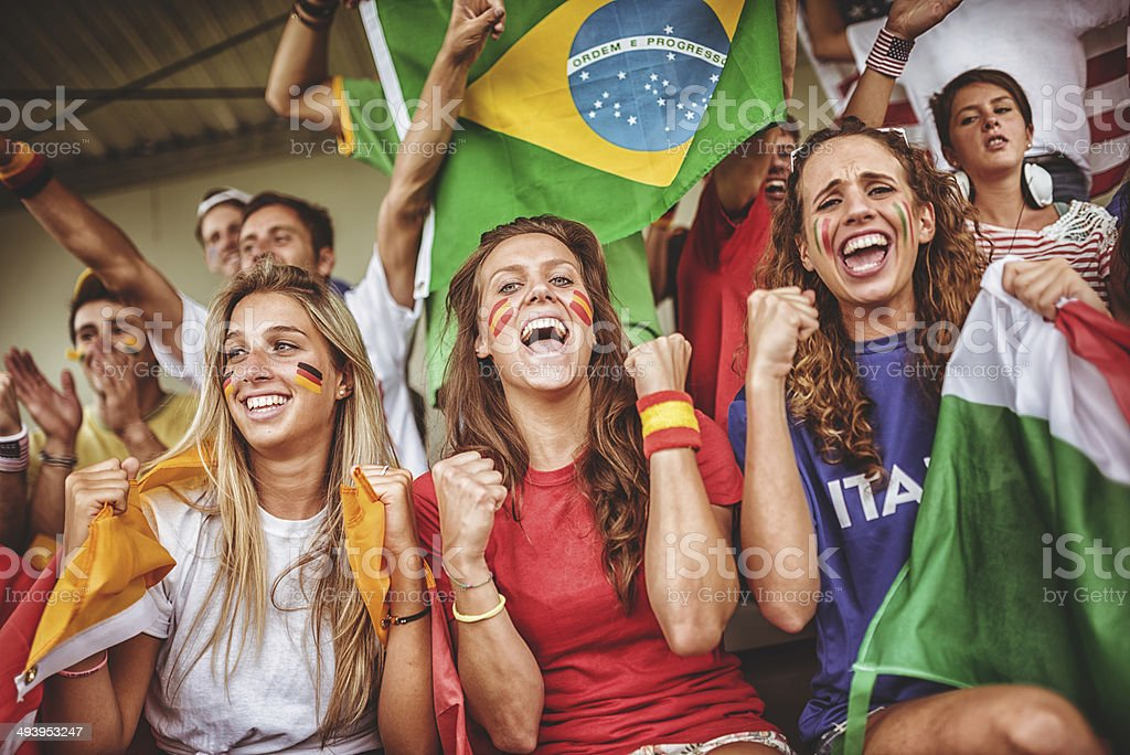 mixed national world supporter at the soccer stadium royalty-free stock photo